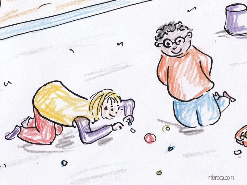 Une fille et un garçon jouent aux billes