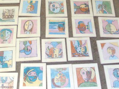 20 crayons oxydes représentant des portraits.