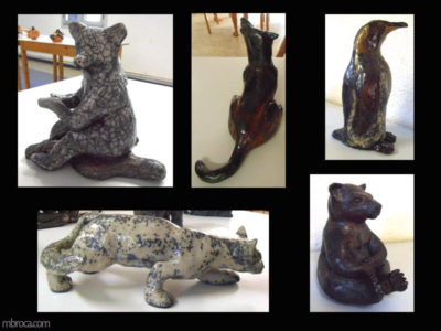 un ours assis, un loup hurlant, un pingoin, un chat et un ours.