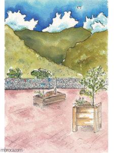 œuvres vue de la place de la mairie de mosset. Des bacs avec plantations, un muret et des montagnes en arrière plan.