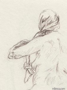 une femme torse nu de dos, les cheveux dans un tissu